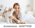 Stock photo pets morning comfort rest and people concept happy young woman with cat in bed at home 463077058