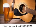Glass Of Beer Near Acoustic...