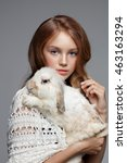young teen girl with rabbit.... | Shutterstock . vector #463163294
