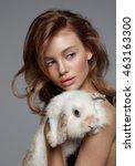 young teen girl with rabbit.... | Shutterstock . vector #463163300