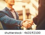 two businessman shaking hands | Shutterstock . vector #463192100
