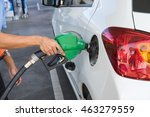 man fills up car with a... | Shutterstock . vector #463279559