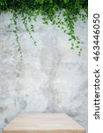 Wooden Table With Concrete Wal...