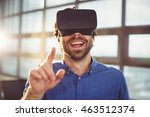 Small photo of Male business executive using virtual reality headset in office