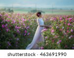 Stock photo beautiful woman in a floral park garden roses makeup hair a wreath of roses long wedding dress 463691990