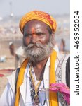 Small photo of ALLAHABAD, INDIA - MARCH 07, 2013 : Portrait of unidentified Sadhus the holyman sitting at confluence of the Ganges and Yamuna River during the festival Kumbh Mela. Allahabad, India.