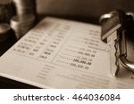 rows of coins on account book... | Shutterstock . vector #464036084