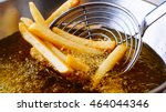 cooking french fries. close up... | Shutterstock . vector #464044346