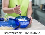 a woman is stirring dough with... | Shutterstock . vector #464103686