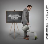 Small photo of Abnormal profit text on blackboard with businessman