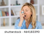 woman with asthma using an... | Shutterstock . vector #464183390
