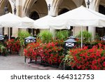 Tables With White Umbrellas An...
