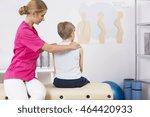 physiotherapist correcting body ...   Shutterstock . vector #464420933