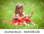 beautiful little girl picking... | Shutterstock . vector #464438138