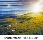 day and night composite image of mountain landscape with stones laying among the grass on the hill side - stock photo