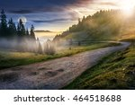 composite day and night illustration of road through the foggy meadow near spruce forest in mountains - stock photo