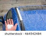 Hail Falls On A Blue Car Roof.