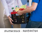 close up of man delivers crate... | Shutterstock . vector #464544764