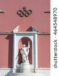 Small photo of Rome, Italy - August 6th 2016. Canoeist marble statue with olympic game rings symbol