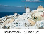 windmill and buildings at oia... | Shutterstock . vector #464557124