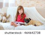 Adorable Little Girl Reading...