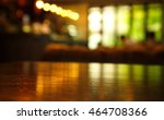 Stock photo blur light reflection on table in bar at night background 464708366