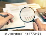 man hand holding magnifying... | Shutterstock . vector #464773496