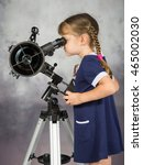 Small photo of Girl amateur astronomers looking into the telescope eyepiece