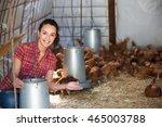 Happy Female Farmer Holding...