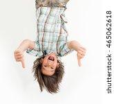 little boy hanging upside down   Shutterstock . vector #465062618