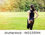 young woman runner doing leg