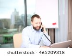 young bearded employee looking... | Shutterstock . vector #465209318