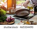 jug pours liquid on pan. green... | Shutterstock . vector #465334490