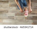 woman hands tying sport shoes | Shutterstock . vector #465341714