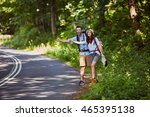 attractive couple hitchhiking... | Shutterstock . vector #465395138
