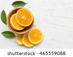 orange slices in bowl on white... | Shutterstock . vector #465559088