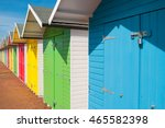 Multi Coloured Beach Huts In...