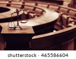 Small photo of Symbol of law and justice in the empty courtroom, law and justice concept.