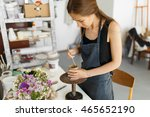 female potter creating a bowl... | Shutterstock . vector #465652190