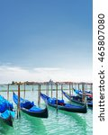 several gondolas parked beside... | Shutterstock . vector #465807080