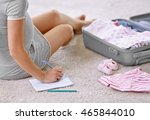 pregnant woman packing suitcase ... | Shutterstock . vector #465844010