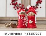 two wooden christmas elves in...   Shutterstock . vector #465857378