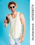 cheerful young man in hat and... | Shutterstock . vector #465858074