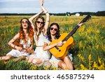 Three Cute Hippie Girl Sitting...