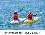 Two Young Ladies Kayaking.