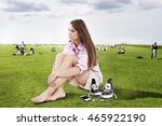 the girl has a rest on a hot... | Shutterstock . vector #465922190