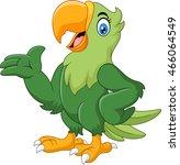 cartoon happy parrot presenting   Shutterstock .eps vector #466064549