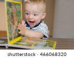 baby boy turns the page in the... | Shutterstock . vector #466068320
