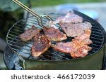tasty meat slices on barbecue | Shutterstock . vector #466172039
