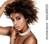 Small photo of Beauty photo of young elegant african american woman with afro. Girl wearing pearls. Glamour makeup. Studio shot.